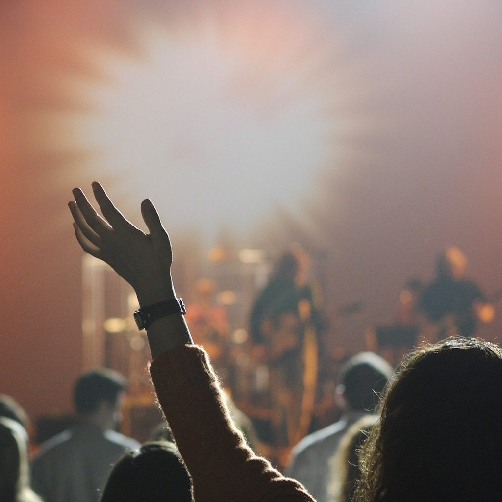 Need God-a worshipper surrendering to God with her hand raised.